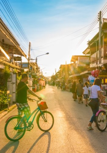 Chiang Khan Loei Thailand Tourists walking and cycling in walking street of retro village