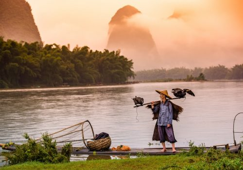 Fisherman of Guilin Li River and Karst mountains Guangxi China