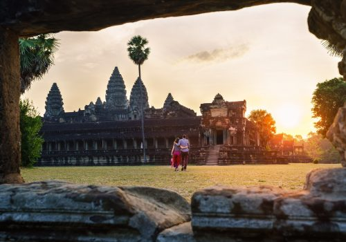 Travel-couple-in-Angkor-Wat-at-sunrise-moment-Siem-Reap-Cambodia