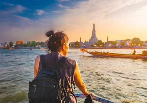 boat view Wat Arun at sunset Chao Phraya river Famous water landmark travel Bangkok Thailand